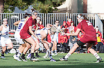 Los Angeles, CA 02/08/13 - Erin Fitzgerald  (Northwestern #7), Tanner Guarino  (Umass #15) and Kelsey McGovern  (Umass #2) in action during the Northwestern vs UMass NCAA Women's Lacrosse game at USC's McAlister Field.
