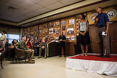 United States President Barack Obama and first lady Michelle Obama make their annual trip to greet current and retired members of the U.S. military and their families as they eat a Christmas Day meal in the Anderson Hall mess hall at Marine Corps Base Hawaii at Kaneohe Bay in Kaneohe Bay, Hawaii, USA, on 25 December 2013. <br /> Credit: Kent Nishimura / Pool via CNP