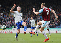 Burnley's Chris Wood Cardiff City's vies for possession with Aron Gunnarsson<br /> <br /> Photographer Rich Linley/CameraSport<br /> <br /> The Premier League - Saturday 13th April 2019 - Burnley v Cardiff City - Turf Moor - Burnley<br /> <br /> World Copyright © 2019 CameraSport. All rights reserved. 43 Linden Ave. Countesthorpe. Leicester. England. LE8 5PG - Tel: +44 (0) 116 277 4147 - admin@camerasport.com - www.camerasport.com