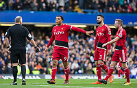 Troy Deeney of Watford holds back teammates as the players dispute Chelseas first goal to the Referee during the Premier League match between Chelsea and Watford at Stamford Bridge, London, England on 21 October 2017. Photo by Andy Rowland.