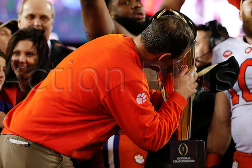 09.01.2017. Tampa, Florida, USA.  Clemson Tigers head coach Dabo Swinney kisses the National Championship Trophy after the 2017 College Football National Championship Game between the Clemson Tigers and Alabama Crimson Tide on January 9, 2017, at Raymond James Stadium in Tampa, FL. Clemson defeated Alabama 35-31.