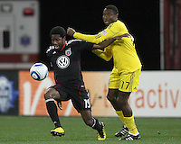 Clyde Simms#19 of D.C. United breaks away from Emmanuel Ekpo#17 of the Columbus Crew during the opening match of the 2011 season at RFK Stadium, in Washington D.C. on March 19 2011.D.C. United won 3-1.