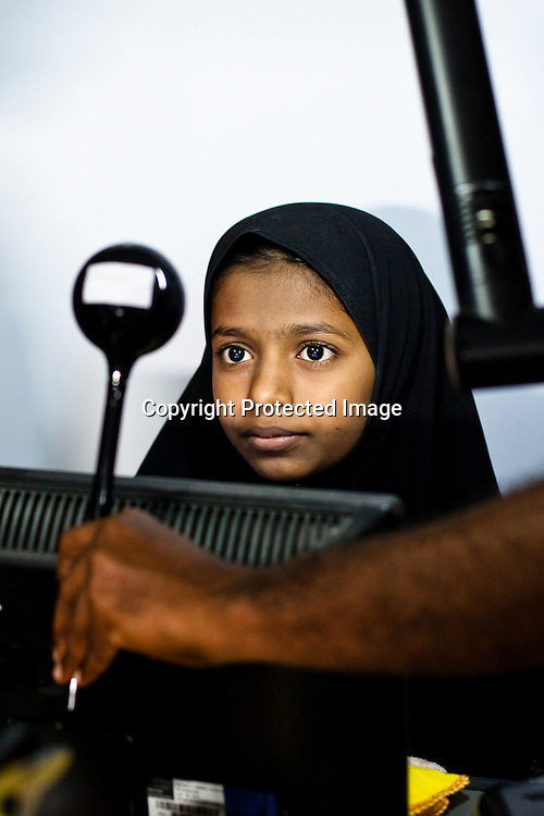 11 year old Sehar Bano sits in front of the camera for the enrollment that is on its way in Naagaaram village, outskirts of Hyderabad in Andhra Pradesh, India. India is assigning each one of its 1.2 billion people a unique ID number based on digital finger prints and iris scan. Photograph: Sanjit Das/Panos