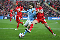 David Silva of Manchester City and Jordan Henderson of Liverpool battle for the ball during the Capital One Cup match between Liverpool and Manchester City at Wembley Stadium, London, England on 28 February 2016. Photo by David Horn / PRiME Media Images.