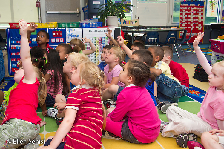 MR / Schenectady, NY. Zoller Elementary School (urban public school). Kindergarten inclusion classroom. Students raise hands at group lesson time. MR: AL-gKs. ID: AL-gKs. © Ellen B. Senisi.