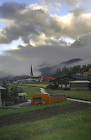 Early morning mist and cloud over farm buildings and church steeple. Imst district, Tyrol/Tirol, Austria, Alps.