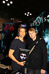 "General Hospital Michael Easton poses with Christopher Shy (cowrote book with Christopher) ""Soul Stealer Collector's Edition"" on October 13, 2012 at the Javits Center, New York City, New York. (Photo by Sue Coflin/Max Photos)"