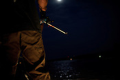Matt Wroe goes bowfishing on the night of June 20, 2013 on Aquia Creek in Virginia. CREDIT: Lance Rosenfield