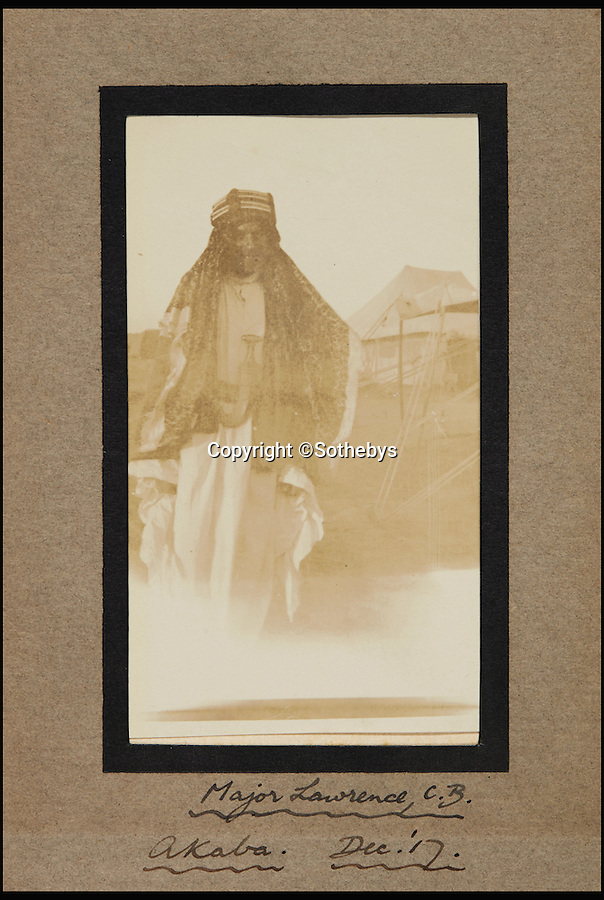 BNPS.co.uk (01202 558833)<br /> Pic: Sothebys/BNPS<br /> <br /> A snapshot taken by an airman with No. 1 Squadron of the Australian Flying Corps at Akaba in late 1917 and shows the legendary hero in full Arab dress.<br /> <br /> An unseen letter in which war hero TE Lawrence wrote 'some day that little business in Arabia will be famous' has been unearthed almost 100 years later.<br /> <br /> The prophetic letter by the man who became known around the world as Lawrence of Arabia is accompanied by a rare photo of him in Arab<br /> headdress and robes.<br /> <br /> The letter is dated Christmas Day 1918 shortly after his return from Arabia at the end of the First World War and before he became a household name.<br /> <br /> It is being sold tomorrow at Sotheby's for an estimated £15,000.