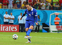 Konstantinos Mitroglou of Greece scores his penalty in the shootout