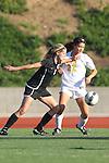 Manhattan Beach, CA 01/25/10 - Elizabeth Caparis (Palos Verdes #4) and Madison Miketa (Mira Costa #22) in action during the Bay League game between Mira Costa and Palos Verdes, Palos Verdes defeated Mira Costa 2-0.