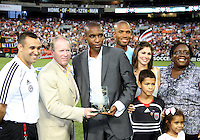 Eddie Pope and family with CEO Kevin Payne of D.C. United during an MLS match against the Los Angeles Galaxy at RFK Stadium on July 18 2010, in Washington D.C. Galaxy won 2-1.