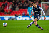 11th January 2020; Bet365 Stadium, Stoke, Staffordshire, England; English Championship Football, Stoke City versus Milwall FC; Jake Cooper of Millwall crosses the ball - Strictly Editorial Use Only. No use with unauthorized audio, video, data, fixture lists, club/league logos or 'live' services. Online in-match use limited to 120 images, no video emulation. No use in betting, games or single club/league/player publications