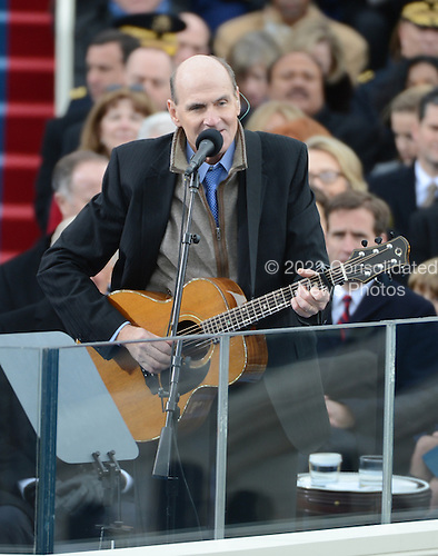 Musician James Taylor sings before President Barack Obama is sworn-in for a second term as the President of the United States by Supreme Court Chief Justice John Roberts during his public inauguration ceremony at the U.S. Capitol Building in Washington, D.C. on January 21, 2013.     .Credit: Pat Benic / Pool via CNP