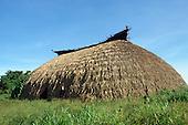 Pavuru, Xingu, Brazil; Sting standing outside an Indian malloca house; Nov 1990.