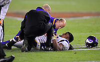 Dec 6, 2009; Glendale, AZ, USA; Minnesota Vikings trainers tend to linebacker E.J. Henderson after suffering an injury in the fourth quarter against the Arizona Cardinals at University of Phoenix Stadium. The Cardinals defeated the Vikings 30-17. Mandatory Credit: Mark J. Rebilas-