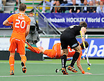 The Hague, Netherlands, June 10: Nick Haig #4 of New Zealand fights for the ball with Sander Baart #13 of The Netherlands during the field hockey group match (Men - Group B) between New Zealand and The Netherlands on June 10, 2014 during the World Cup 2014 at Kyocera Stadium in The Hague, Netherlands. Final score 1-1 (0-1) (Photo by Dirk Markgraf / www.265-images.com) *** Local caption ***