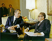 National Security Advisor Doctor Henry A. Kissinger, right, briefs United States President Richard M. Nixon, left, in Washington, D.C. on November 25, 1972.<br /> Credit: White House via CNP