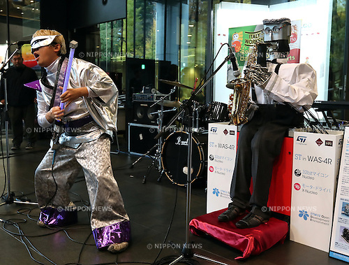 November 23, 2016, Tokyo, Japan - Waseda University's saxophonist robot WAS-5, developed by professor Atsuo Takanishi and Kaptain Rock playinng one string lightsaber guitar perform jam session at the Waseda University in Tokyo on Wednesday, November 23, 2016. Japan and Italy had a two-day technical workshop on robotics interwining with visual arts, music and theatre at Waseda's campus.   (Photo by Yoshio Tsunoda/AFLO) LWX -ytd-