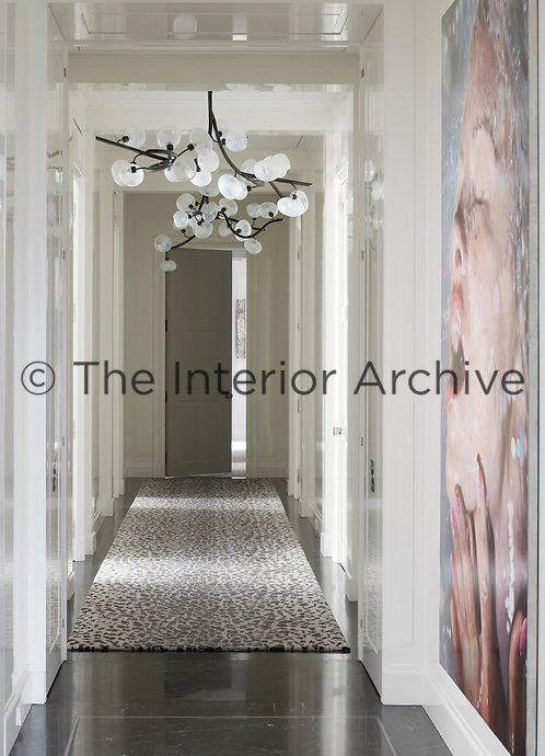 The interior design of the apartment respects the building's 1920s Italian Renaissance-style architecture