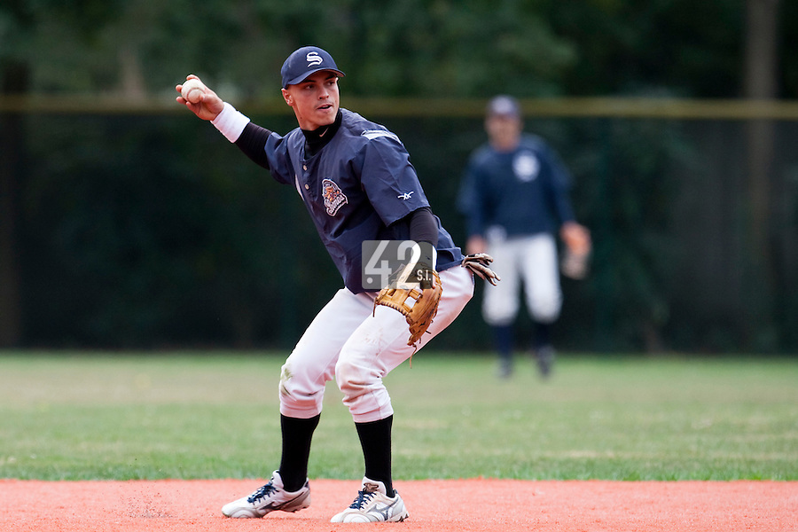 03 october 2009: Yann Dal Zotto of Savigny throws the ball to first base as he warms up prior to game 1 of the 2009 French Elite Finals won 6-5 by Rouen over Savigny in the 11th inning, at Stade Pierre Rolland stadium in Rouen, France.