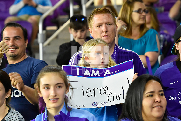 """Orlando, FL - Saturday March 24, 2018: A young fans holds a """"I am a Fierce Girl"""" sign during a regular season National Women's Soccer League (NWSL) match between the Orlando Pride and the Utah Royals FC at Orlando City Stadium. The game ended in a 1-1 draw."""