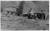 Two Cornet Creek  flood-damaged houses on Oak Street in Telluride.<br /> Telluride, CO  7/27/1914
