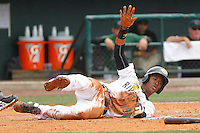 Charleston RiverDogs infielder Abiatal Avelino sliding into home plate during a game against the Augusta GreenJackets at Joseph P.Riley Jr. Ballpark on April 15, 2015 in Charleston, South Carolina. Charleston defeated Augusta 8-0. (Robert Gurganus/Four Seam Images)