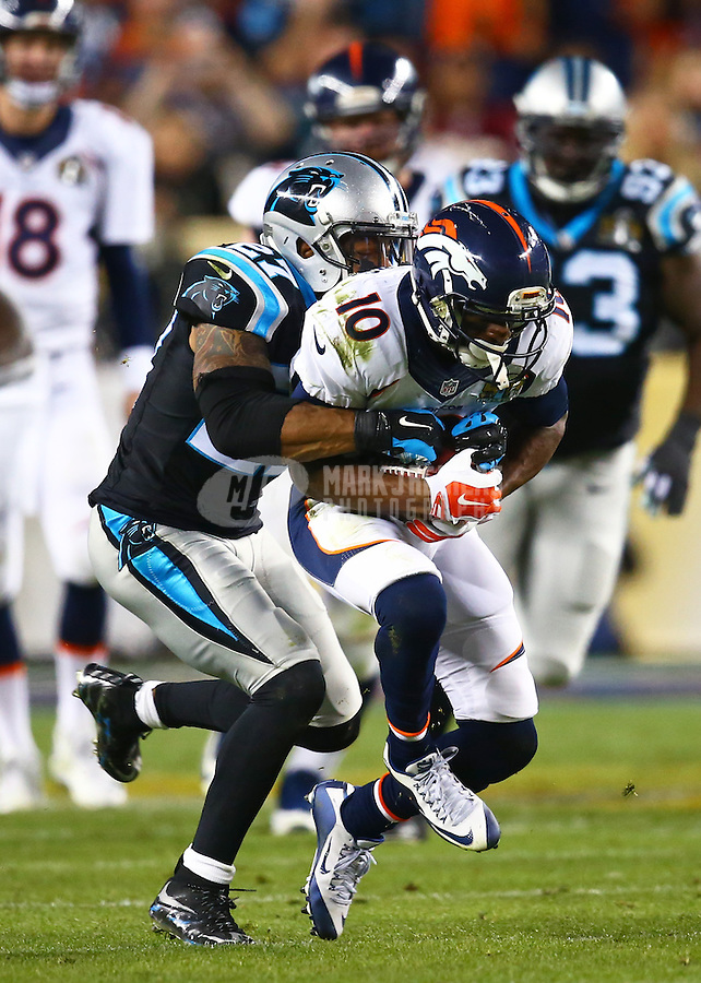 Feb 7, 2016; Santa Clara, CA, USA; Denver Broncos wide receiver Emmanuel Sanders (10) is tackled by Carolina Panthers cornerback Robert McClain (27) in Super Bowl 50 at Levi's Stadium. Mandatory Credit: Mark J. Rebilas-USA TODAY Sports