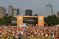 Fans gather at one of the main stages at the Austin City Limits music festival overlooking downtown skyline in Austin.<br />
