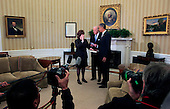 As United States President  Barack Obama looks on, U.S.  Vice President Joseph Biden administers the oath of office to Julia Pierson to become  the Director of the United States Secret Service in the Oval Office of the White House in Washington, D.C. on Wednesday, March 27, 2013..Credit: Dennis Brack / Pool via CNP