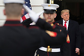 US President Donald J. Trump (R) walks out of the South Portico of the White House behind US Marines to greet Prime Minister of Israel Benjamin Netanyahu (unseen), in Washington, DC, USA, 25 March 2019. Trump later signed an order recognizing Golan Heights as Israeli territory.<br /> Credit: Michael Reynolds / Pool via CNP