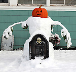 A snowman with a jack-o-lantern head, at the corner of Prospect Street and Union Street in Vernon, after the record breaking pre-Halloween snow storm brought down trees and utility wires leaving more than 700, 000 CL+P customers in the dark, Sunday, October 30, 2011. (Jim Michaud/Journal Inquirer).
