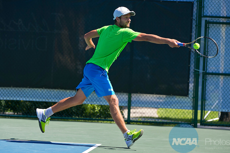 17 MAY 2014:  Hawaii's Petr Michnev hits a backhand during doubles play. University of West Florida defeats Hawaii Pacific University during the Division II Men's Tennis Championship held at Sanlando Park in Altamonte Springs, FL.  West Florida defeated Hawaii 5-3 to win the individual national title.  Matt Marriott/NCAA Photos