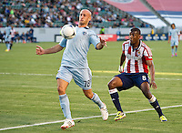 CARSON, CA - April 1, 2012: Aurelien Collins (78) of KC and Oswaldo Minda (8) of Chivas during the Chivas USA vs Sporting KC match at the Home Depot Center in Carson, California. Final score Sporting KC 1, Chivas USA 0.