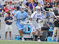 Annapolis, MD - May 20, 2018: Duke Blue Devils Terry Lindsay (11) tries to keep Johns Hopkins Blue Jays Matt Hubler (9) from the ball during the quarterfinal game between Duke vs John Hopkins at  Navy-Marine Corps Memorial Stadium in Annapolis, MD.   (Photo by Elliott Brown/Media Images International)
