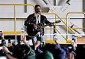 April 16, 2011, Higashi - Matsushima, Japan - Japanese singer and song-writer Tsuyoshi Nagabuchi puts on a good live concert to a cheering crowd of some 1,500 Japan self-defense forces troops at Matsushima Air Base in Higashi-Matsushima, Miyagi Prefecture, on Saturday, April 16, 2011. The soldiers have been deployed to the areas devastated by the March 11 earthquake and tsunami to conduct search-and-rescue missions for missing people and cleanup operations of the debris. (Photo by AFLO) [3620] -mis-