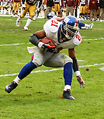 Landover, MD - December 8, 2002 -- New York Giants running back Tiki Barber (21) carries during 2nd quarter action in Landover, Maryland.  The Giants won the game 27 - 21.<br /> Credit: Ron Sachs / CNP<br /> [NOTE: No New York Metro or other Newspapers within a 75 mile radius of New York City]