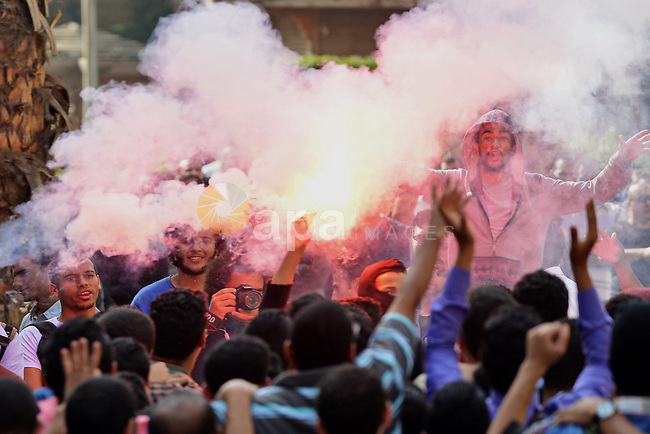 Egyptian students who support Muslim Brotherhood and ousted president Mohammed Morsi, shot slogans during a demonstration against military rule, at Cairo University, in Cairo, Nov. 09, 2014. Photo by Amr Sayed