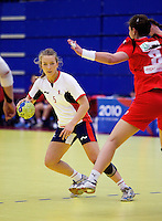 31 MAR 2010 - LONDON, GBR - Britains Nina Heglund (#5) looks for a way past the Icelandic defence in the two teams 2010 European Womens Handball Championships qualifier .(PHOTO (C) NIGEL FARROW)