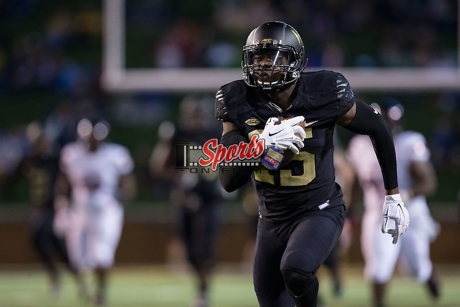 Cortez Lewis (15) of the Wake Forest Demon Deacons runs down the sidelines for a 78-yard touchdown during first half action against the Louisville Cardinals at BB&T Field on October 30, 2015 in Winston-Salem, North Carolina.  The Cardinals defeated the Demon Deacons 20-19.  (Brian Westerholt/Sports On Film)