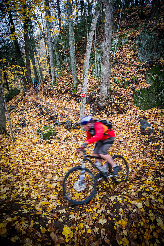 Mountain biking the Noquemanon Network's South Trails of Marquette Michigan in autumn.