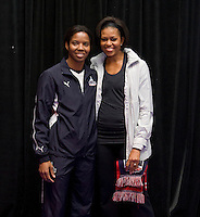 First Lady Michelle Obama stands with Briana Scurry, Washington Freedom goalkeeper, during a US Soccer Foundation clinic held at City Center in Washington, DC.