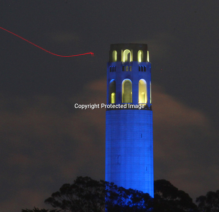 May's full moon rose over the San Francisco Coit Tower as seen Aquatic Park Pier, SF., CA.