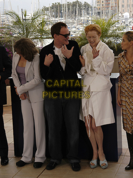 QUENTIN TARANTINO TILDA SWINTON.Photocall for the Jury of.Cannes Film Festival, France 12 May 2004.full length full-length white coat dress open toe stripy wedge espadrille shoes hand gesture.sales@capitalpictures.com.www.capitalpictures.com.©Capital Pictures
