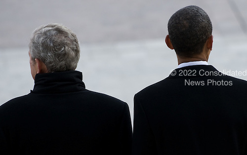 Washington, DC - January 20, 2009 -- United States President Barack Obama stands beside former US President George W. Bush as Bush prepares to leave the US Capitol on the presidential helicopter after Obama was sworn in as the 44th US president in Washington, DC, on January 20, 2009. .Credit: Saul Loeb - Pool via CNP