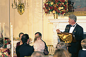 United States President Bill Clinton, right, offers a toast during an Official Dinner hosted by he and first lady Hillary Rodham Clinton in honor of Chancellor Helmut Kohl of Germany in the State Dining Room of the White House in Washington, DC on Thursday, February 9, 1995.<br /> Credit: John Harrington / Pool via CNP