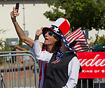 Gilbert and Gabriella take selfies during Star Spangled Sparks on Wednesday July 4, 2018 in downtown Sparks.