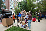 DePaul President A. Gabriel Esteban, Ph.D., and his wife, Josephine,n talk with freshman Natalie Esh and her dad Andrew Esh during Move In Day.  Photo by Diane M. Smutny