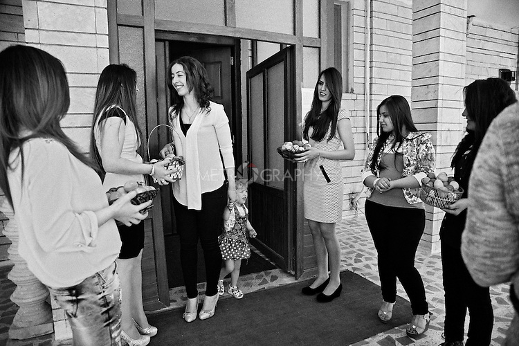 4.4..2015, Kirkuk,Iraq: Easter day at the Maryosof church. Colored eggs where distributed as a ceremony gift.